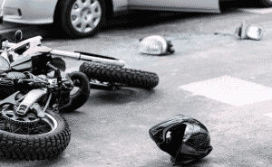the aftermath of a motorcycle accident between a motorbike and a car