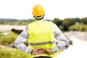Construction worker suffering from back injury at work